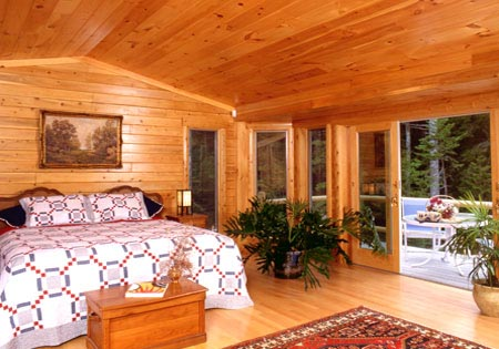 Log home bedroom with a lot of natural light