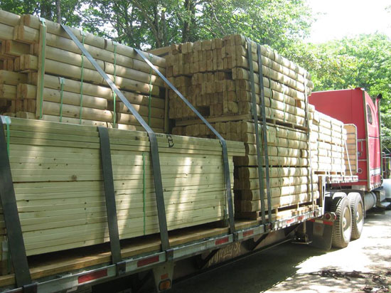 Log cabin package on truck for delivery