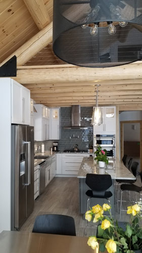 Hybrid home kitchen with exposed ceiling joists