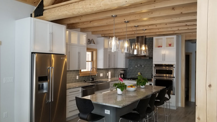 Modern lighting in hybrid home kitchen