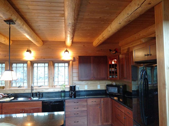 Madison Log Home Kitchen with round beams