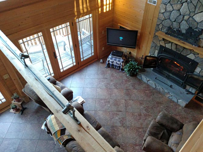 Madison Log Home Loft looking down to Living Room