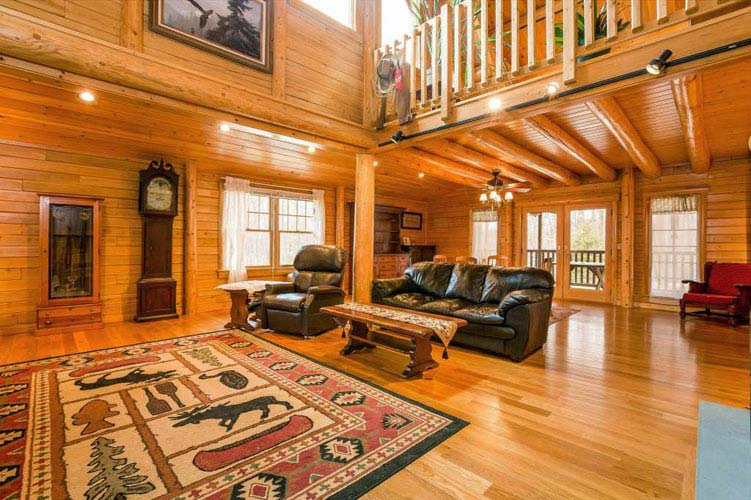 Coopersburg Log Home Great Room with leather furniture
