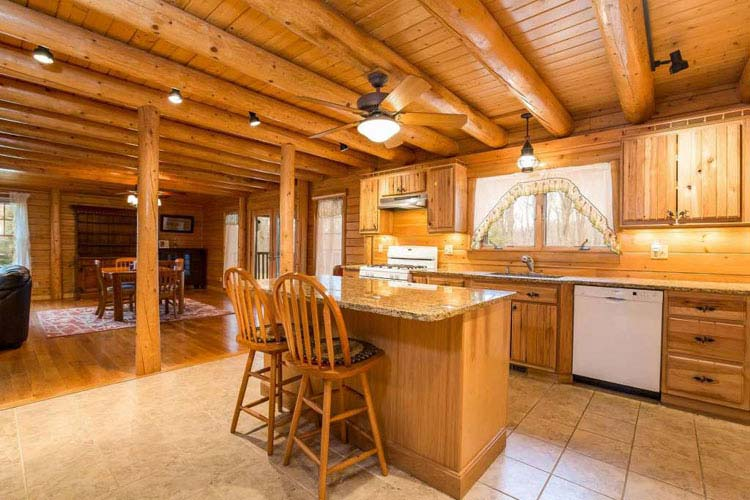 Coopersburg Log Home Kitchen with round beams