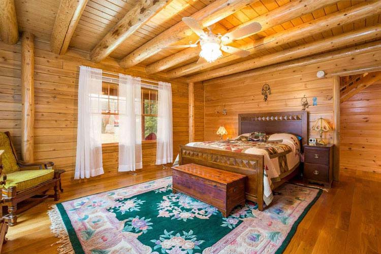 Coopersburg Master Bedroom with round beams