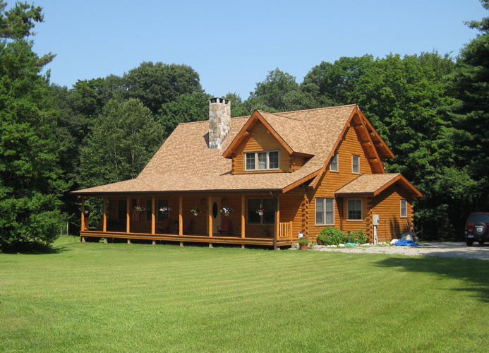Coopersburg Ward Log Home stained light brown with full front porch