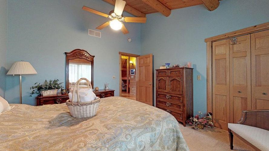 Blue bedroom with wood ceilings