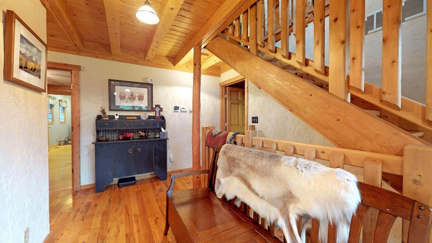 Entryway to Ward Log Home with wooden bench