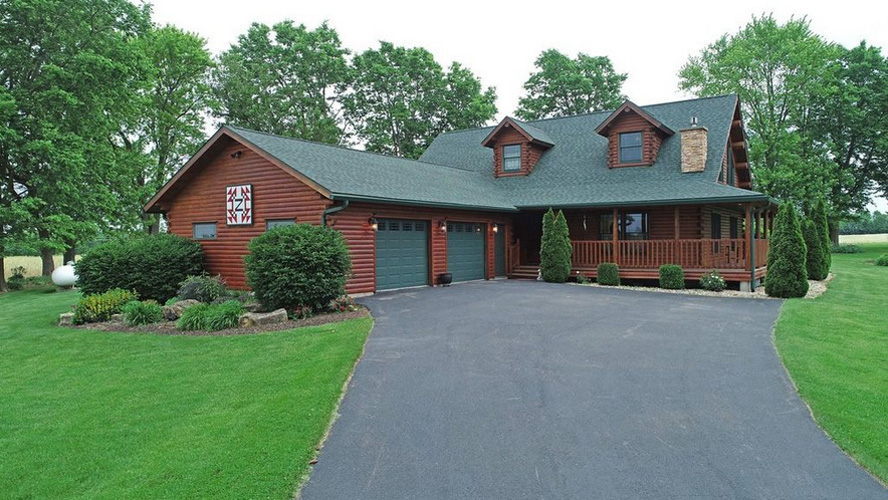 Ward Log Home exterior with two car garage