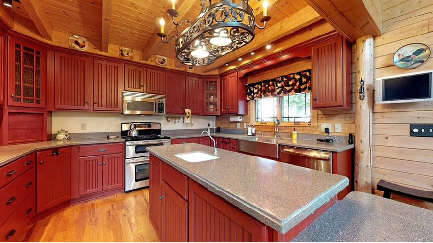 Dark cabinets and light countertops in Ward log home