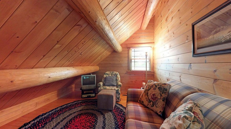 Loft in Ward Log home with large wood beams and sofa couch