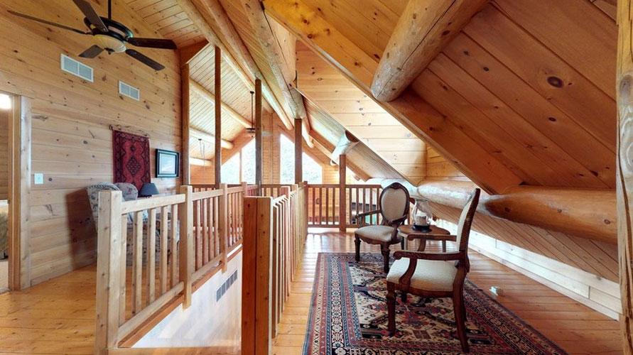 Ward Cedar Log Home loft sitting area with two chairs