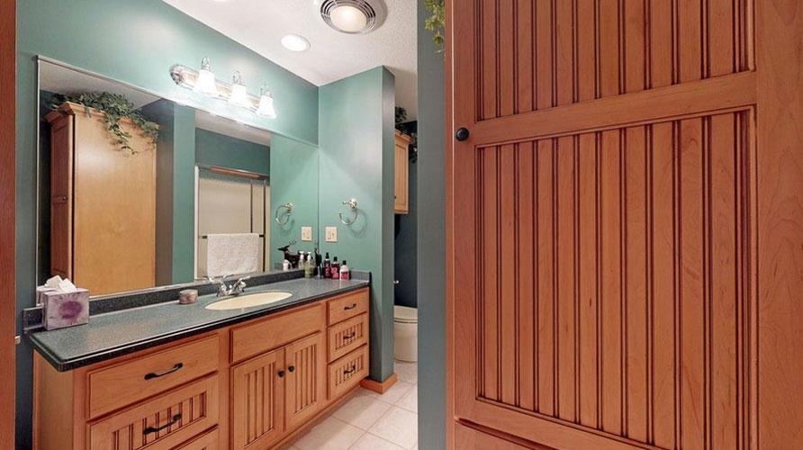 Teal colored bathroom with large vanity