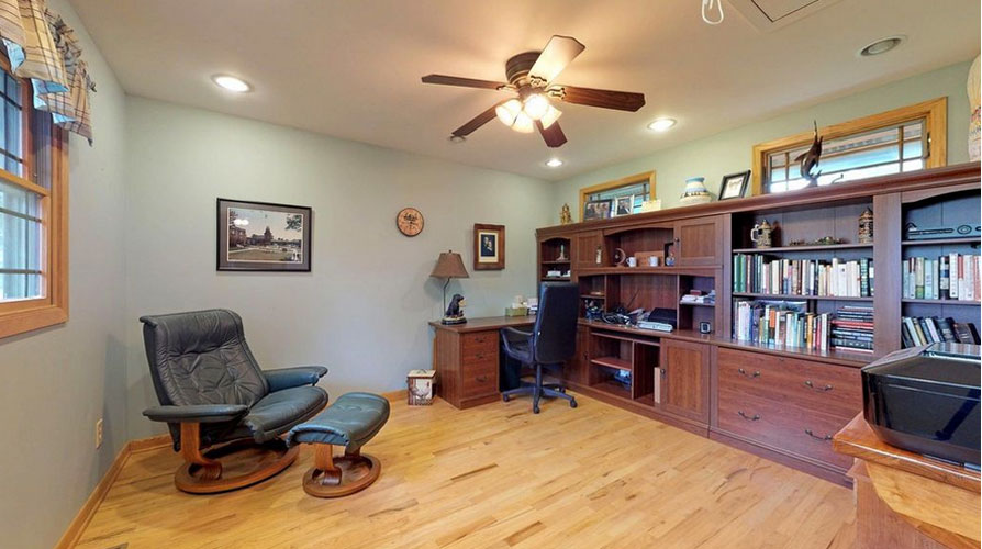 Office with large built in shelves