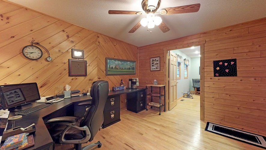 Office space in log home with T&G walls and drywall ceiling
