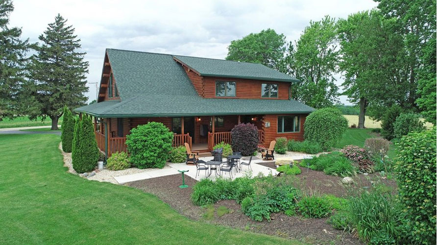 Ward Log Home exterior with shed dormer