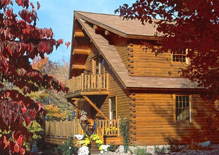Exterior of log home with balcony