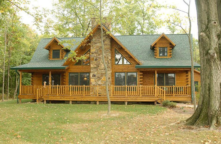 Indy log home exterior with deck