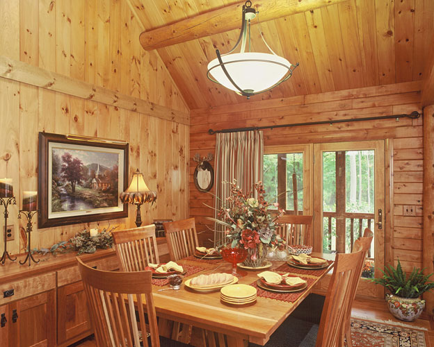 Indy log home dining room with chandelier