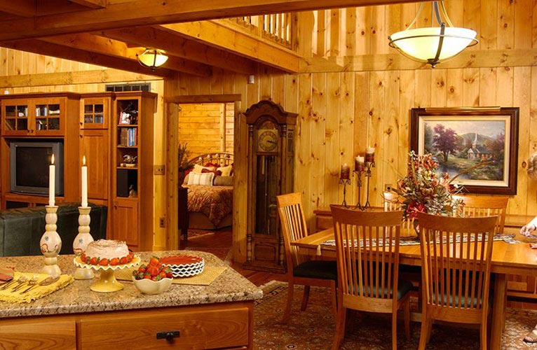 Indy log home kitchen facing toward great room