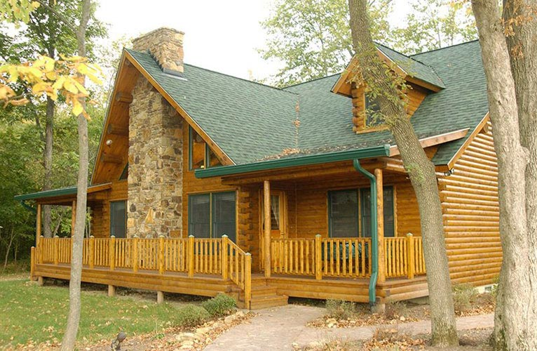 Indy log home exterior with deck space for entertaining