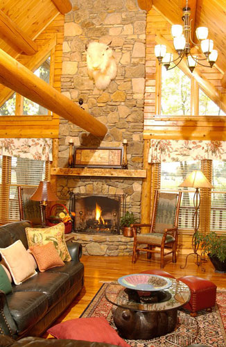 Large fireplace in log home with beams