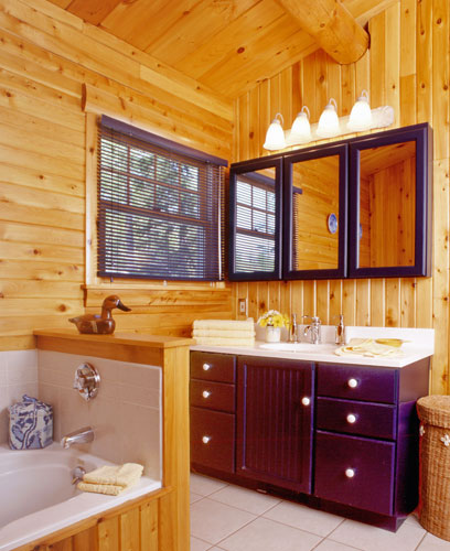 Log home bathroom with large dark cherry vanity