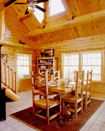 Dining room in log home with cathedral ceilings