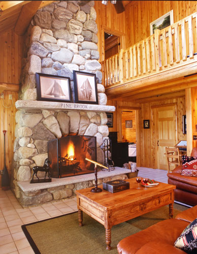 Stone fireplace in log home Great Room