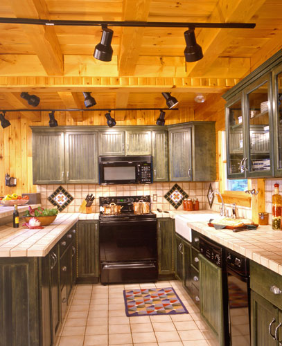 Log home kitchen with track lighting