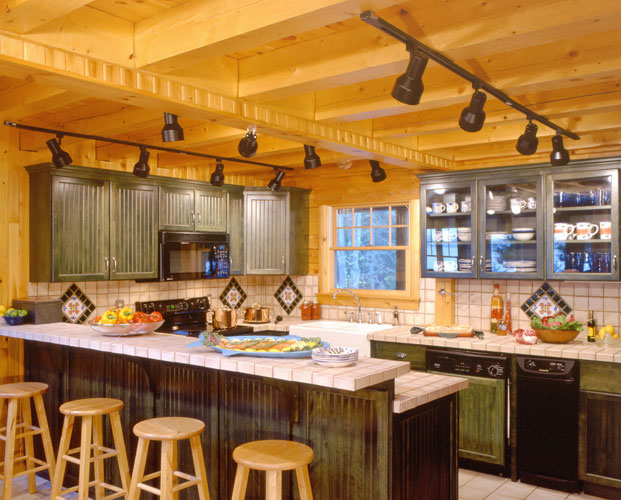 Kitchen in log home with bar counter for extra seating
