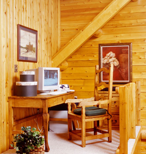 Office nook in loft of log home