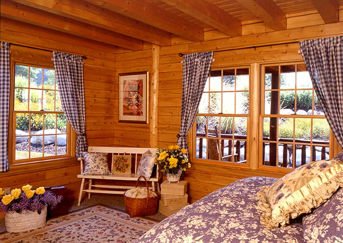 Coopersburg Log Home Bedroom with lots of windows