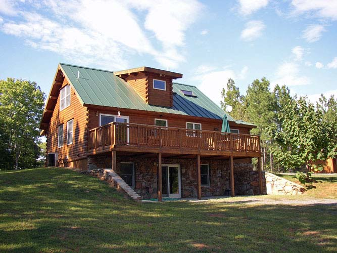 Exterior of log home with daylight basement