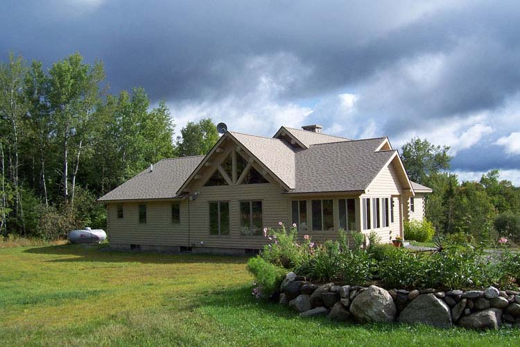Log home exterior stained gray