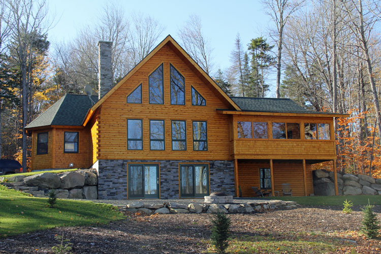 Log home with lots of gable glass