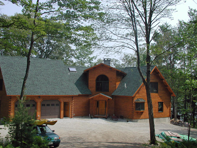 Log Home exterior with attached garage