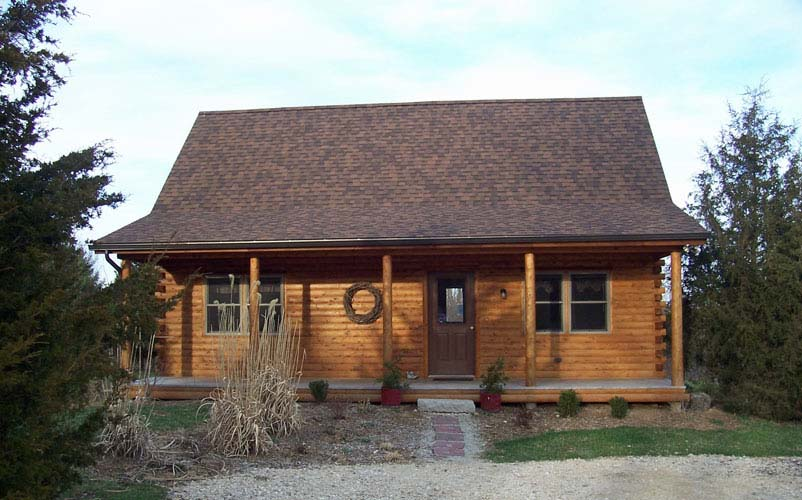 Musquash log cabin with front porch