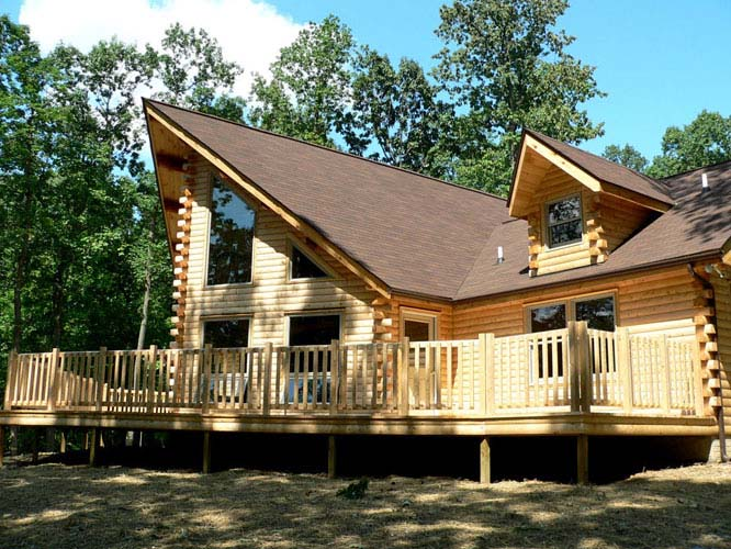 Exterior of log home with large deck
