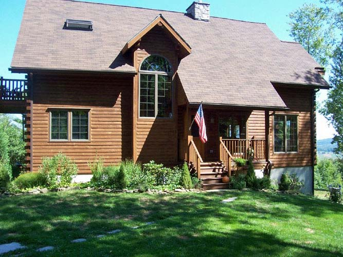 Point Judith log home exterior with entry porch