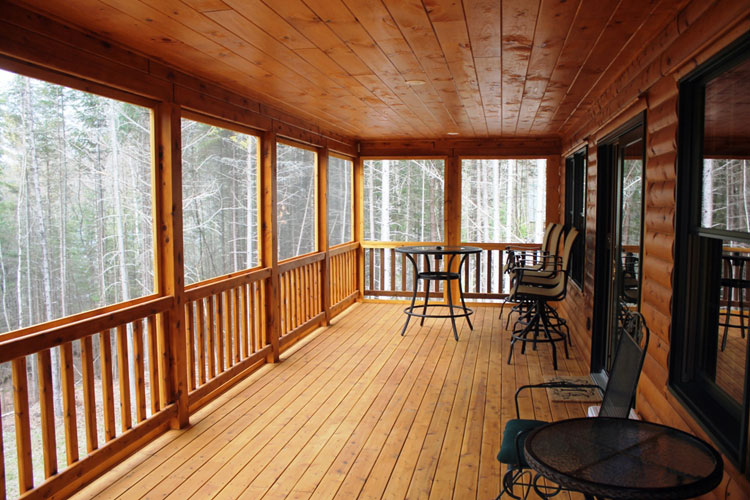 Long covered log home porch