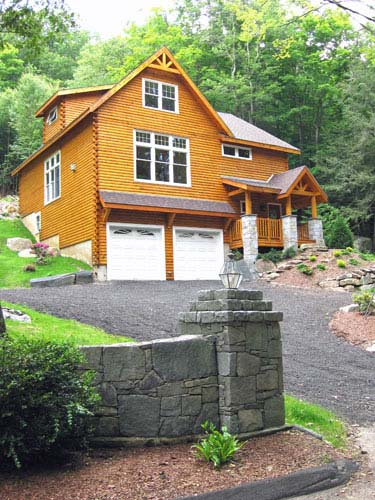 Log home exterior with garage