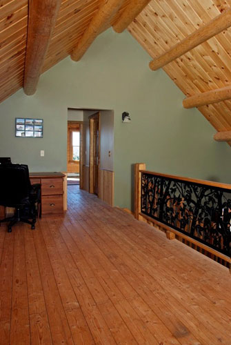 Log Home Hybrid loft with round beams