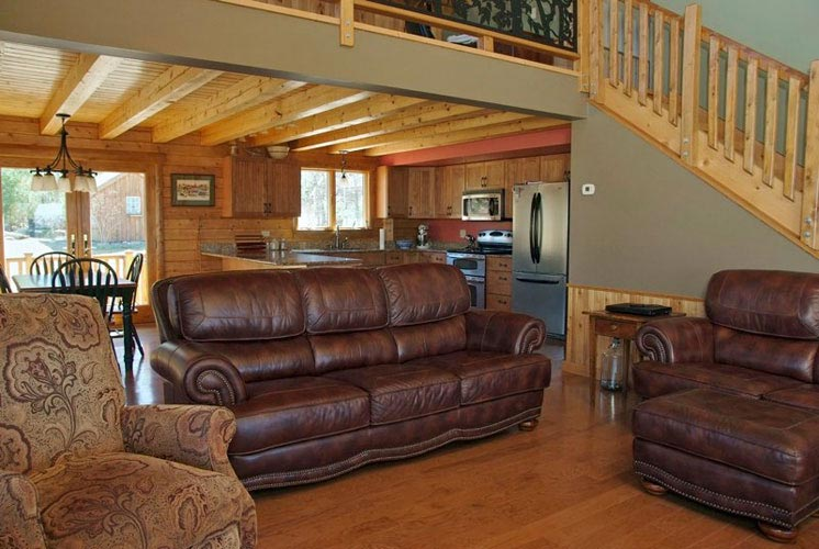 Log Home Hybrid Great Room with woods floors