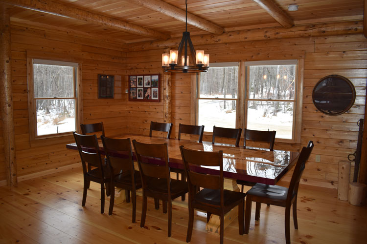Log Home Dining room with custom table