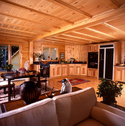 Log home kitchen view from living room