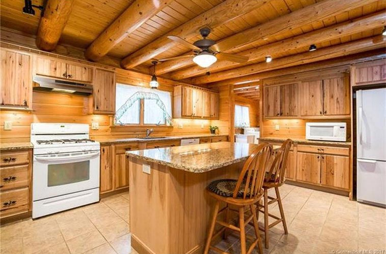 Log Home kitchen with round beams