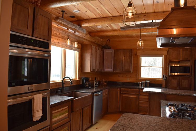 Log Home Kitchen with stainless steel appliances