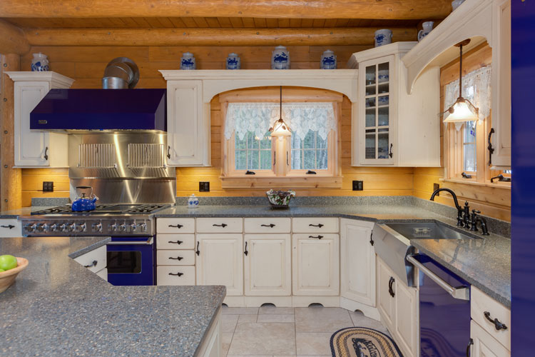 Kitchen with blue appliances and white cabinets
