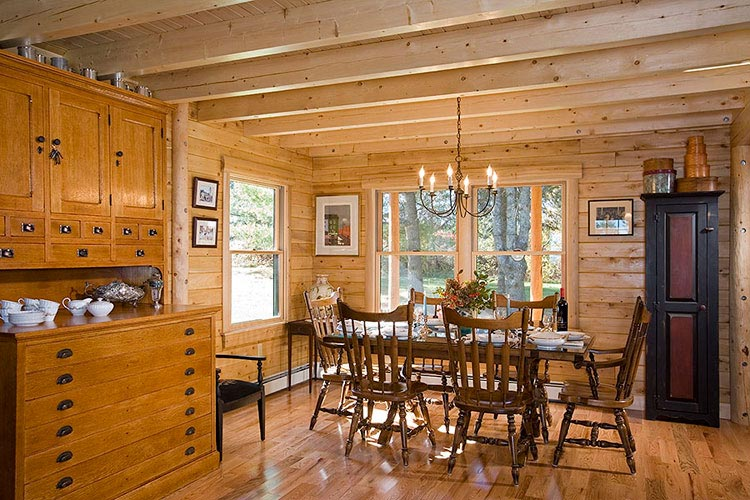 Log home dining room with exposed square ceiling joists